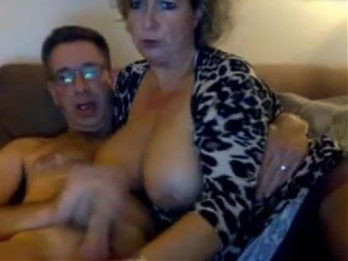 Big tits on MILF sucking as her man cums on her